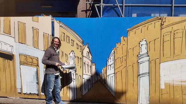 Photo of Nachtburgemeester maakt 'striptekening-straat' op Primark bouwplaten