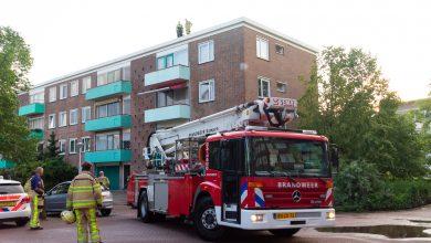 Photo of Man aangehouden op dak flat Schuurmanstraat