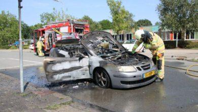 Photo of Cabrio in brand onder het rijden